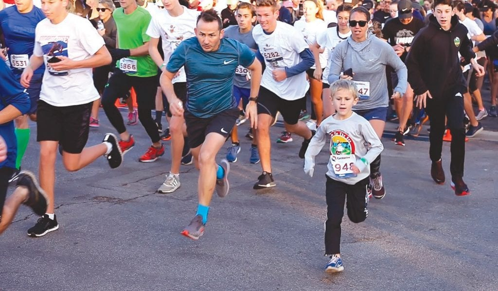FRONT RUNNER—Six year-old Teddy Baker of Simi Valley leads the pack at the start of the 805 Strong 5K Run/Walk on Sunday at Thousand Oaks High School. The run, organized by a TOHS alum, raised money for the Ventura County Community Foundation in support of the Conejo Valley Victims Fund and Hill/Woolsey Fire Sudden and Urgent Needs Effort. Photos by DIANNE AVERY/Acorn Newspapers